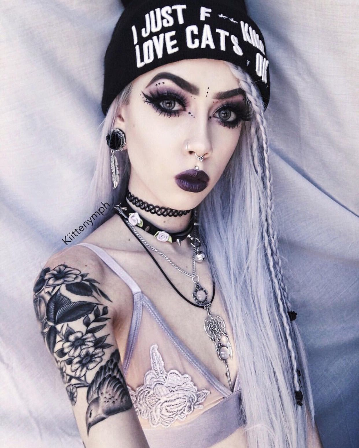 Emo teen with gauges plays with pussy